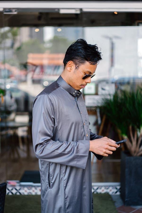 Man Wearing Gray Dress Shirt royalty free stock photography