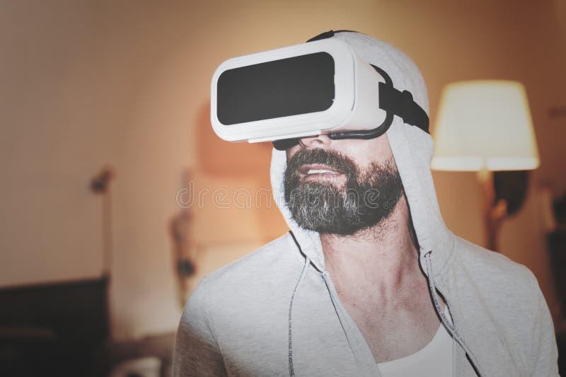 Man Wearing Gray Hoodie and White Virtual-reality Headset stock photo