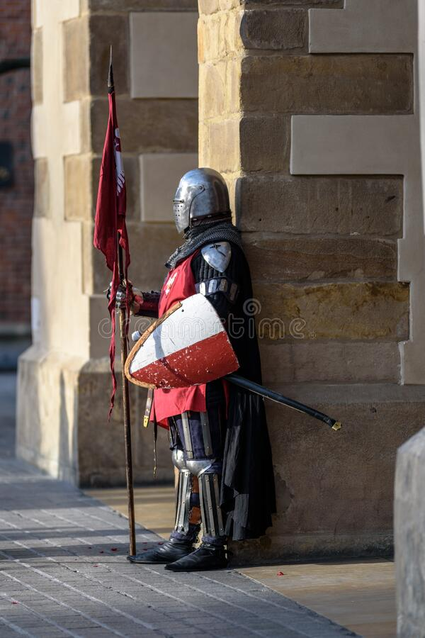 Man Wearing Gray And Red Armour Standing On The Streets Free Public Domain Cc0 Image