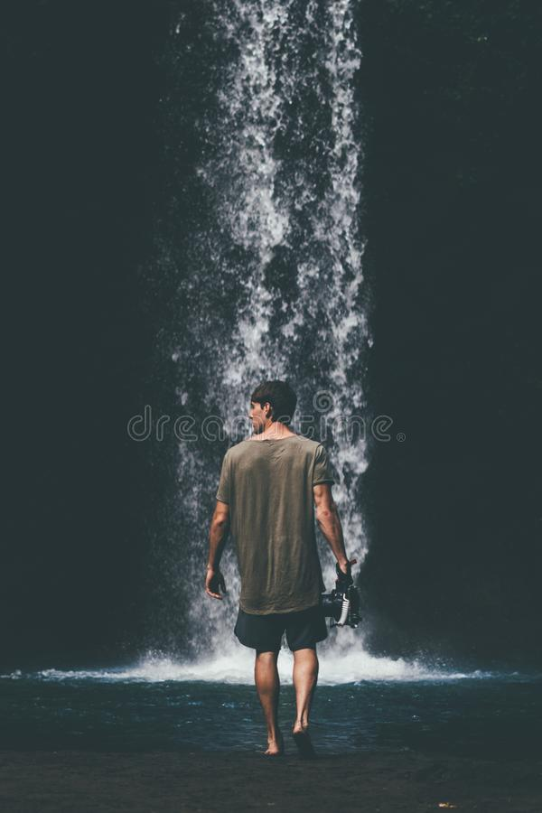 Man Wearing Gray Shirt Walking Near Waterfalls stock images