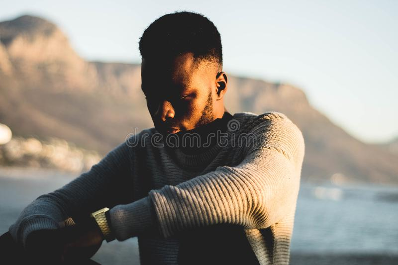 Man Wearing Gray Sweater in Selective Focus Photography royalty free stock images