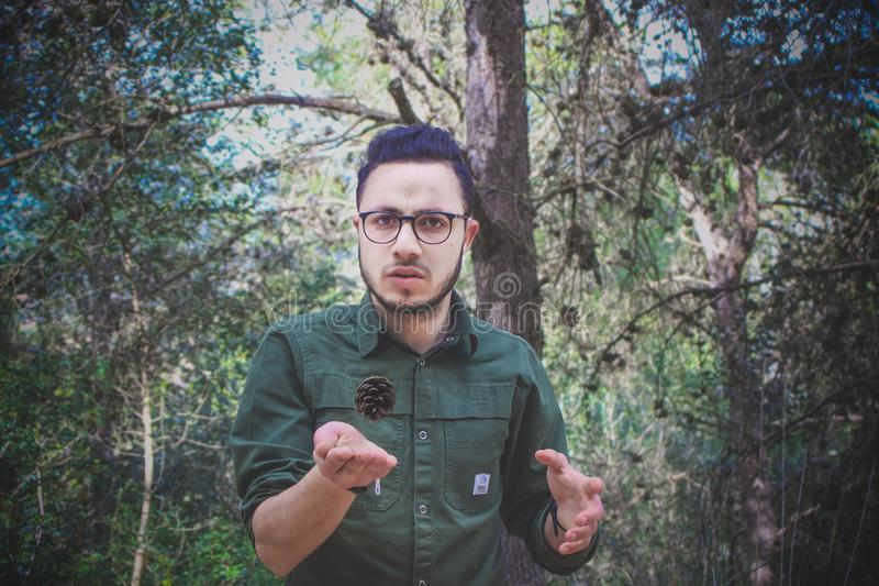 Man Wearing Green Dress Shirt and Surrounded by Trees stock image