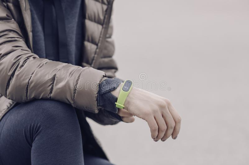 Man wearing green electronic watch stock photography