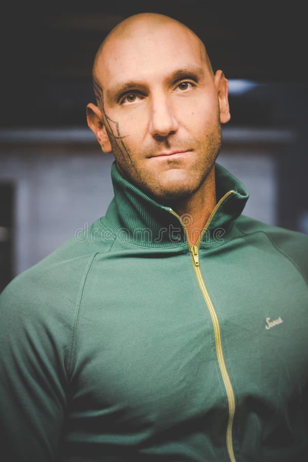 Man Wearing Green Zip-up Top stock photo