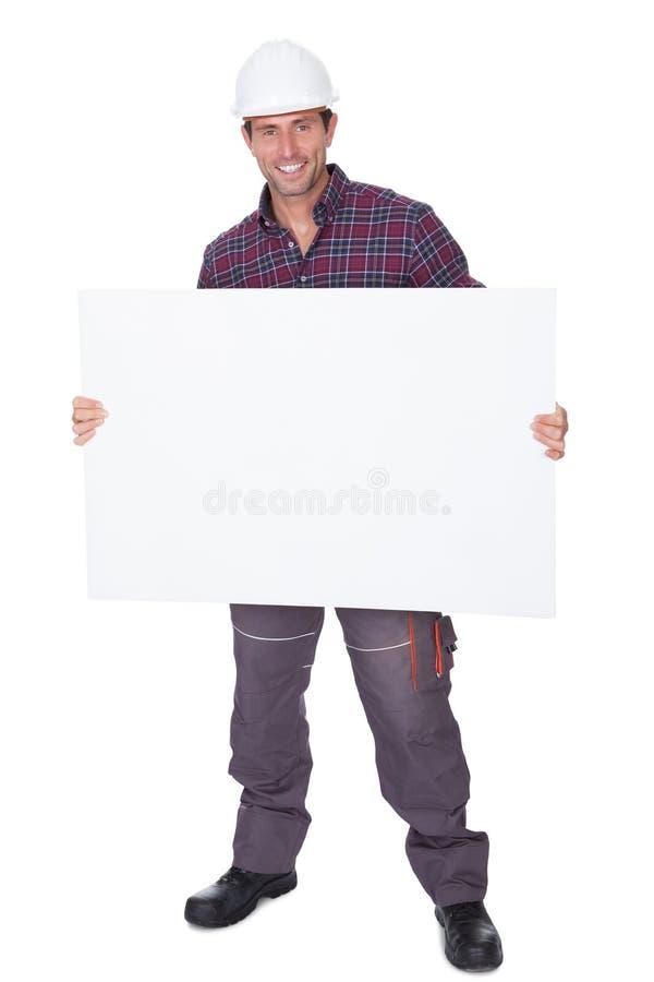 Man Wearing Hard Hat Holding Placard Stock Images