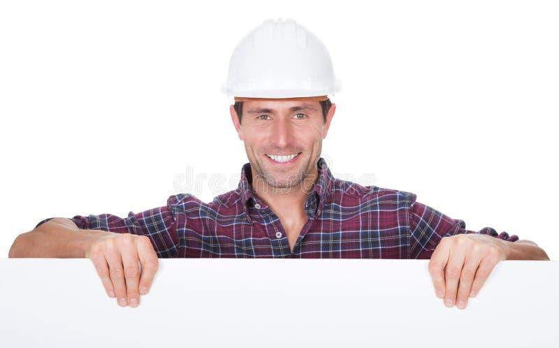 Download Man Wearing Hard Hat Holding Placard Stock Image - Image: 28342635