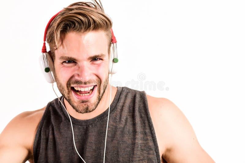 Man wearing headphones playing music. unshaven man listening music in headset. sexy muscular man listen sport music. man royalty free stock image