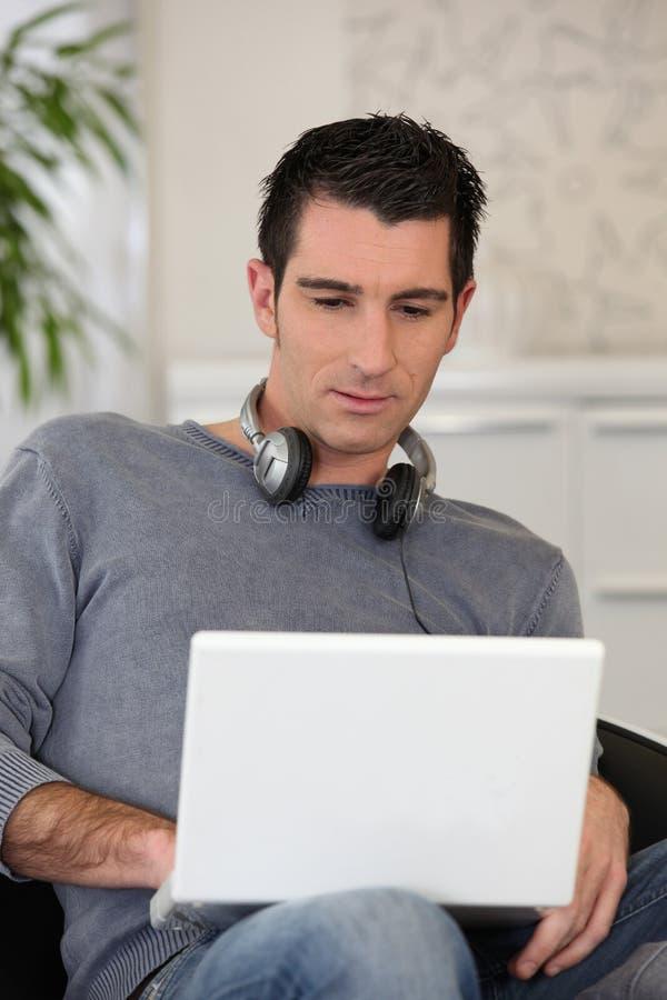 Man wearing headphones royalty free stock photography