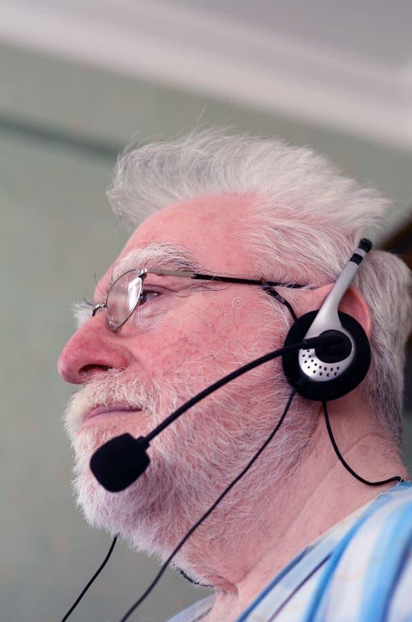 Man wearing headset stock images