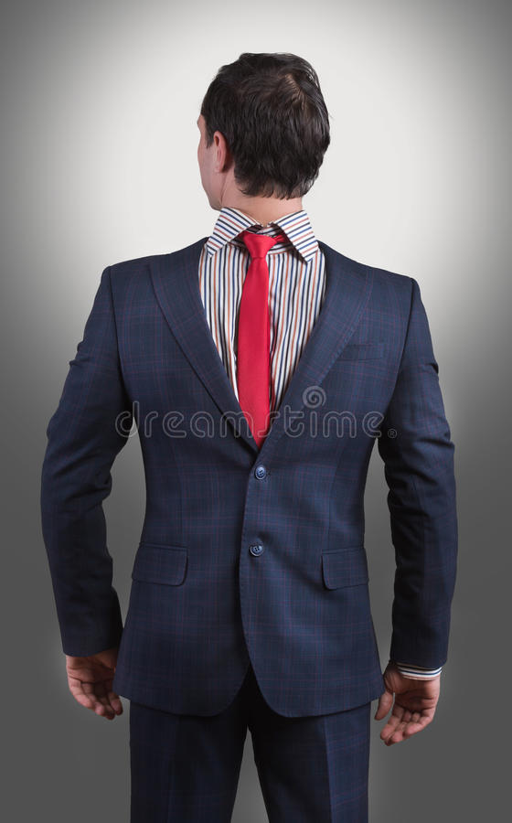 Man wearing his suit on backwards royalty free stock images