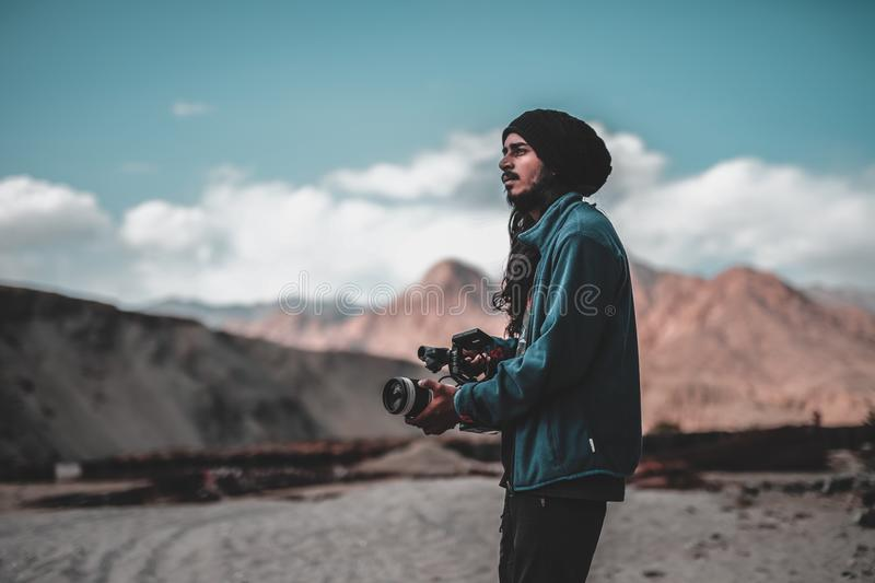 Man Wearing Jacket Holding Dslr Camera On Desert Free Public Domain Cc0 Image