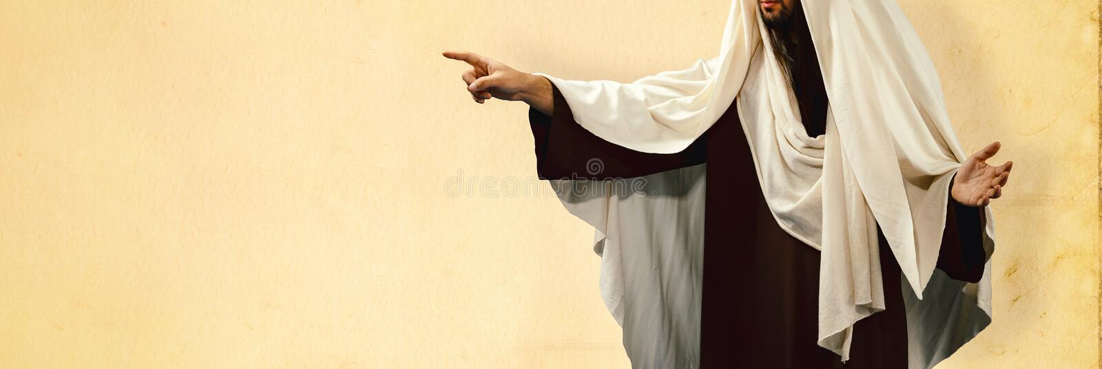 Jesus Christ pointing finger to the side. Man wearing Jesus Christ costume pointing with hand and finger to the side royalty free stock image