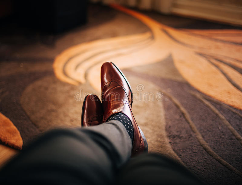 Man wearing leather shoes stock images
