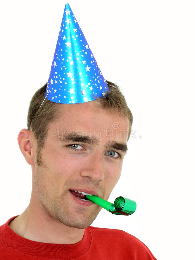Man wearing a party hat stock images