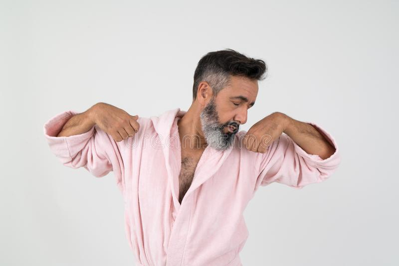 Man Wearing Pink Bathrobe With Both Hands on Shoulder royalty free stock image