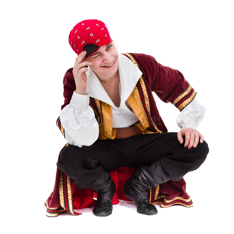 Man wearing a pirate costume posing, on white stock photography