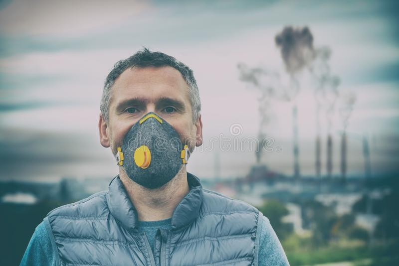 Man wearing a real anti-pollution, anti-smog and viruses face mask stock image