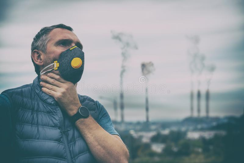 Man wearing a real anti-pollution, anti-smog and viruses face mask stock photo