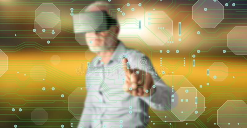 Man wearing a reality virtual headset touching a digital technology concept on a touch screen. With his finger stock photo