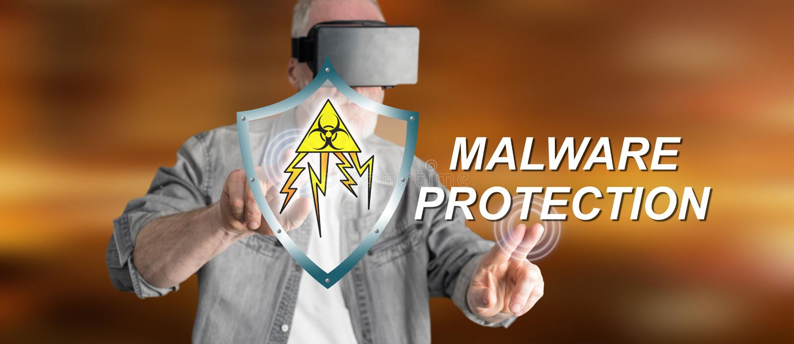 Man wearing a reality virtual headset touching a malware protection concept on a touch screen stock image