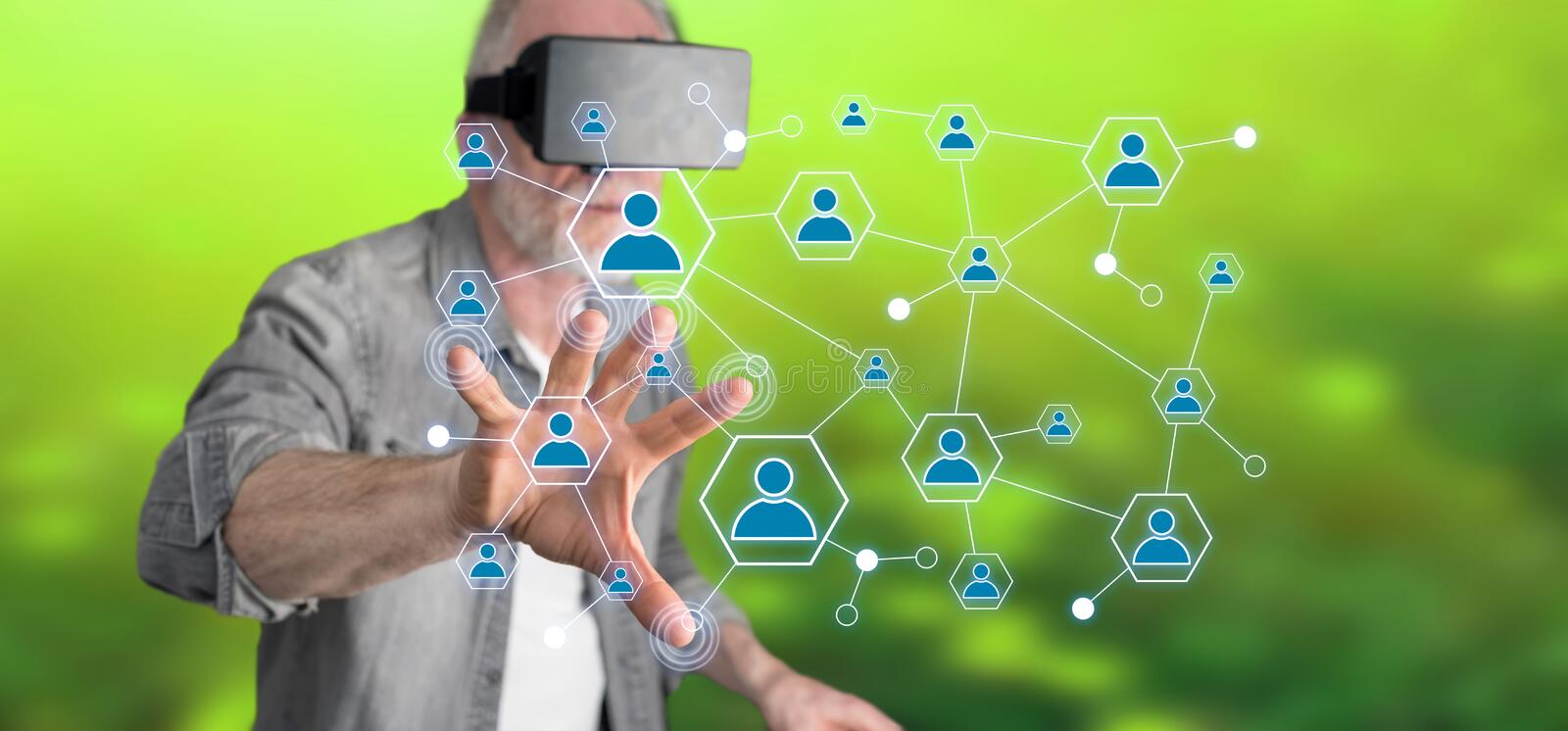 Man wearing a reality virtual headset touching a social network on a touch screen. With his finger royalty free stock photos