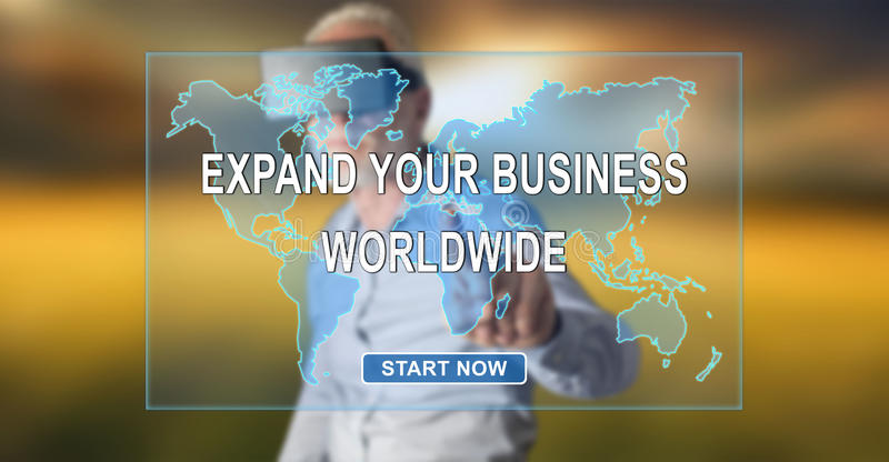 Man wearing a reality virtual headset touching a worldwide business development concept on a touch screen. With his finger stock images