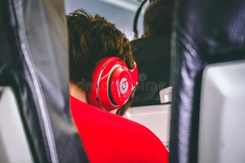 Man Wearing Red Beats By. Dre Headphones royalty free stock photo