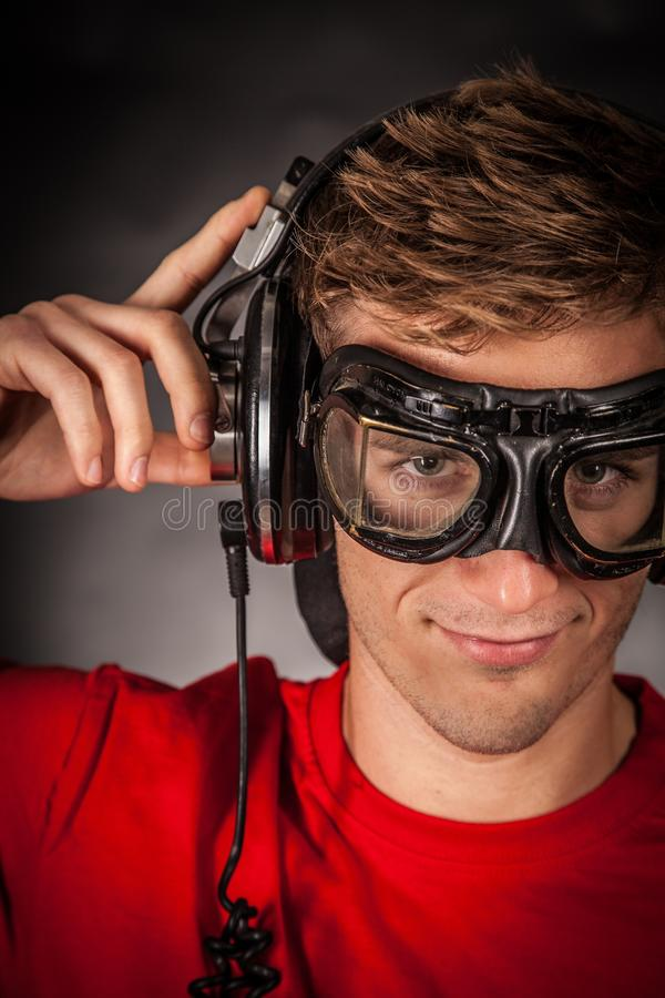 Man Wearing Red Crew Neck Shirt and Black Goggles royalty free stock images