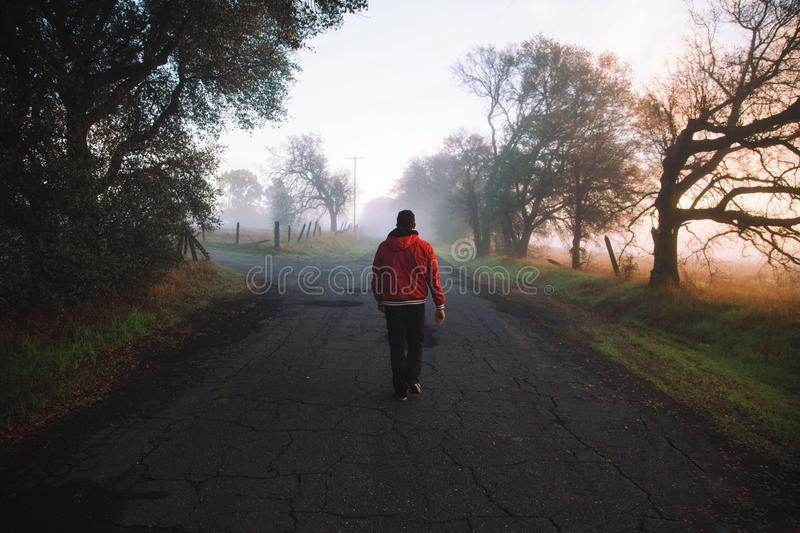 Man Wearing Red Hooded Jacket Standing On Road Free Public Domain Cc0 Image