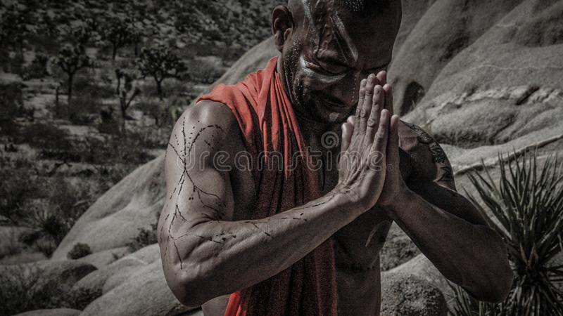 Man Wearing Red Scarf Praying stock image