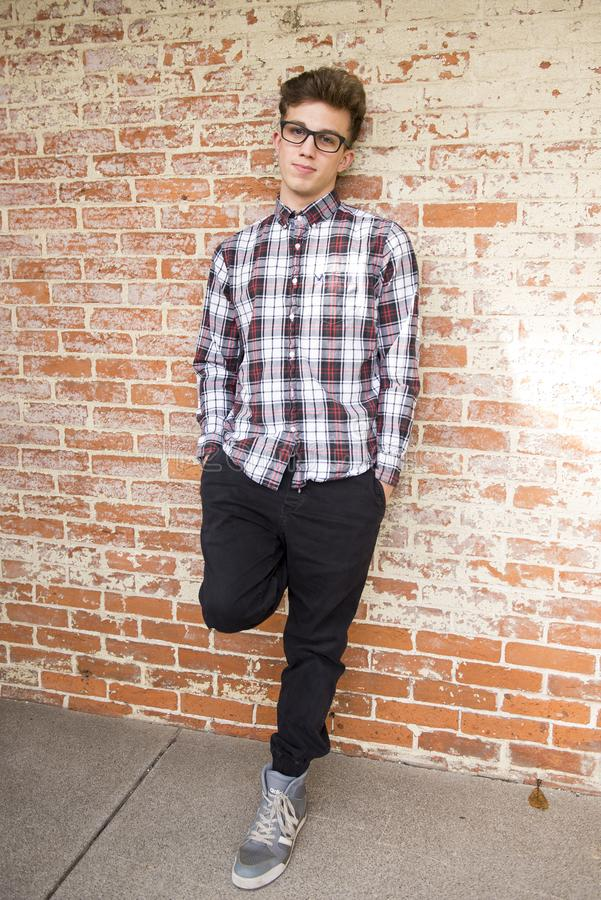 Man Wearing Red And White Plaid Dress Shirt And Black Pants stock images