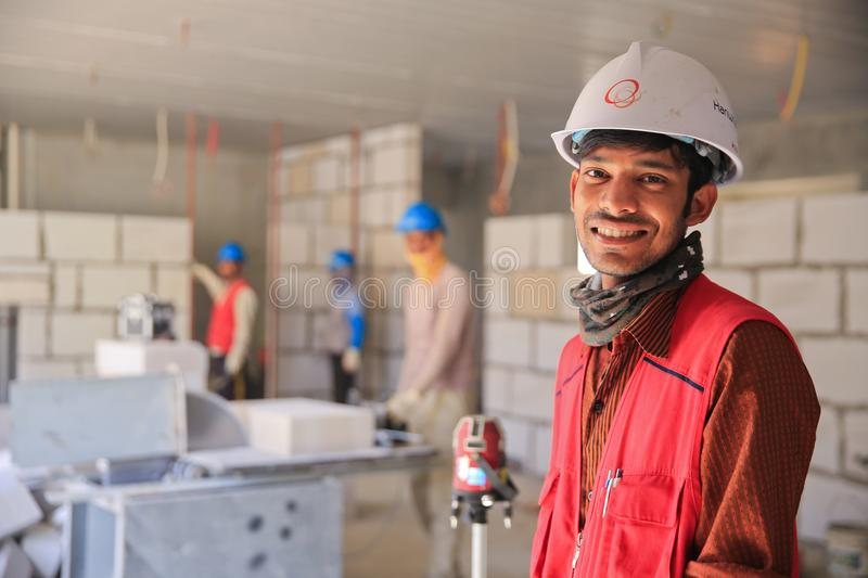 Man Wearing Red Zip-up Vest and White Helmet Smiling stock photography
