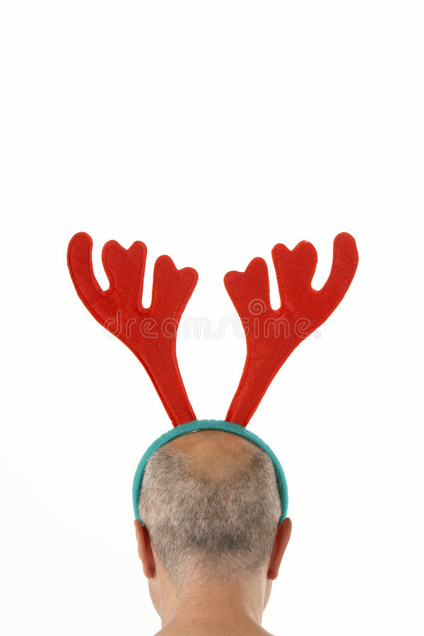 Man Wearing Reindeer Antlers. Against White Background stock photography