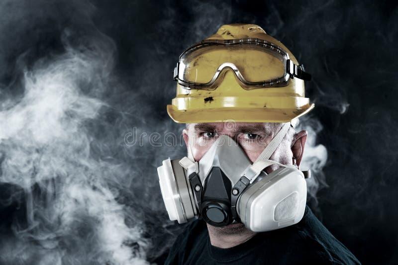 Man wearing respirator stock photography