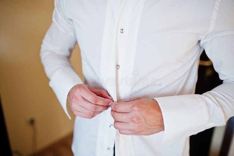 Man wearing shirt. Groom morning at wedding day. royalty free stock image
