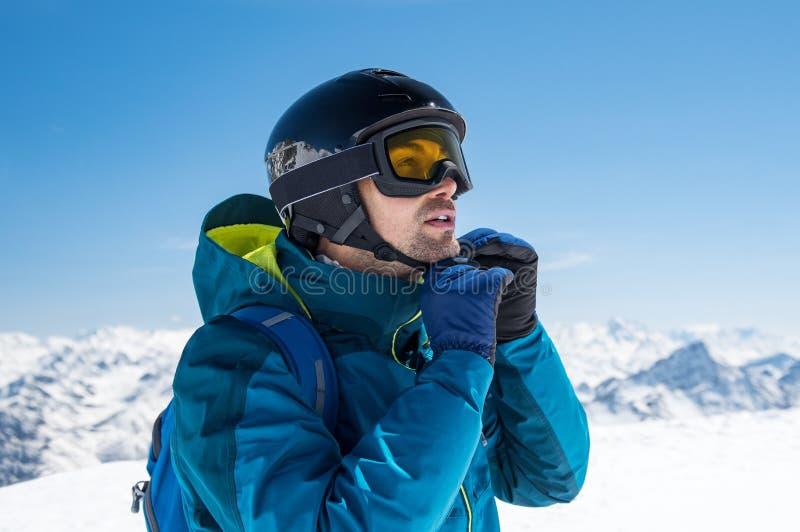 Man wearing ski helmet royalty free stock images