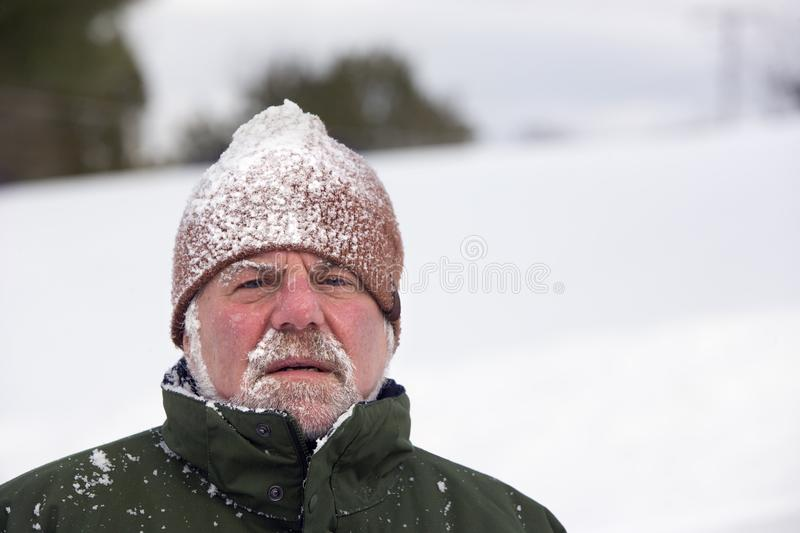 Man Wearing Snow Covered Cap royalty free stock photo