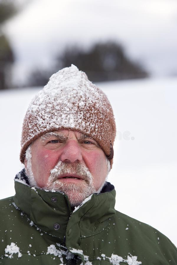Man Wearing Snow Covered Cap stock photography