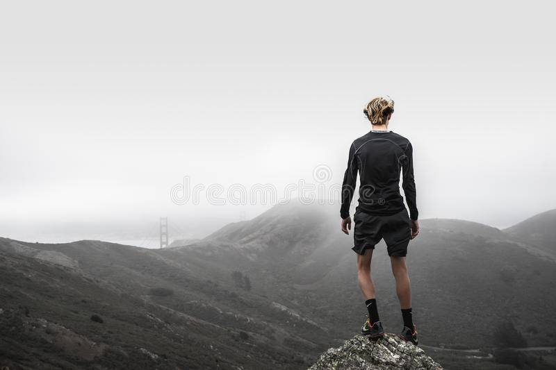 Man Wearing A Sports Attire Standing In Front Of A Mountain Free Public Domain Cc0 Image