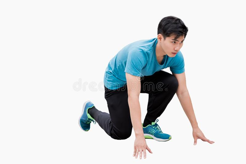 Man wearing sportswear poses ready to run. Isolated on white background stock image