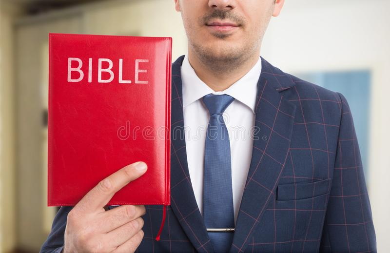 Man presenting bible royalty free stock photography