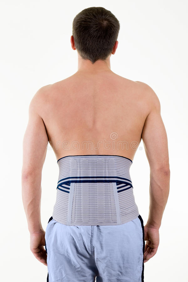 Man Wearing Supportive Brace on Lower Back stock image