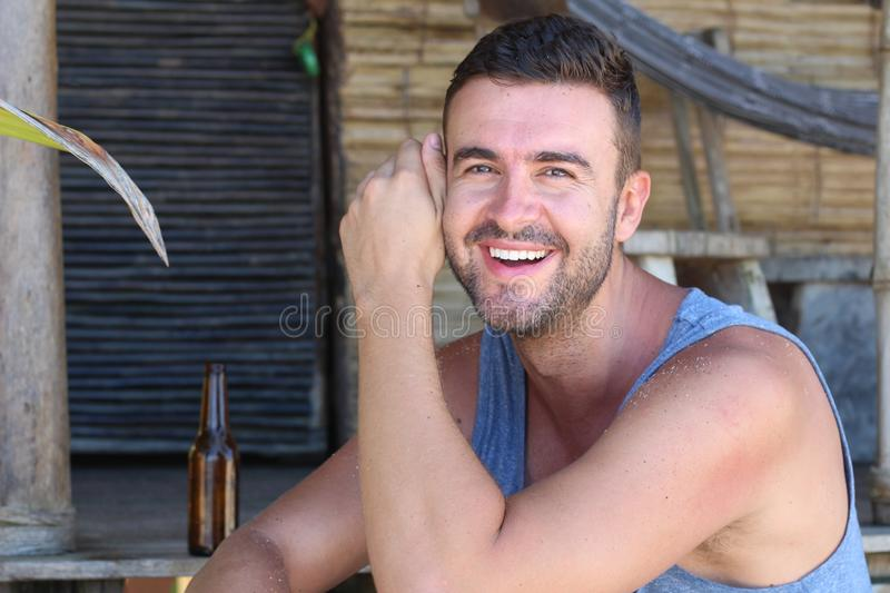 Man wearing a tank top in the summer royalty free stock photography