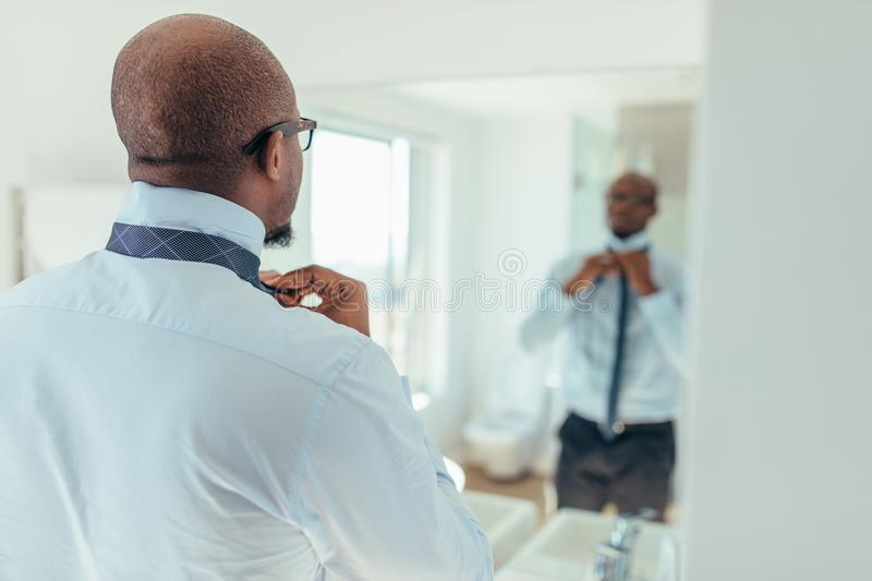 Man wearing a tie royalty free stock image