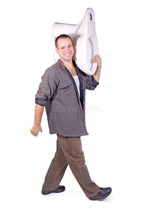 Man wearing a toilet. On white background stock photo