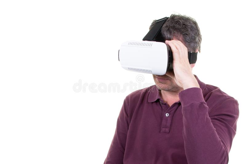 Man wearing using virtual reality VR glasses helmet headset on white background. Smartphone using with virtual reality goggles. Man wearing using virtual stock photo