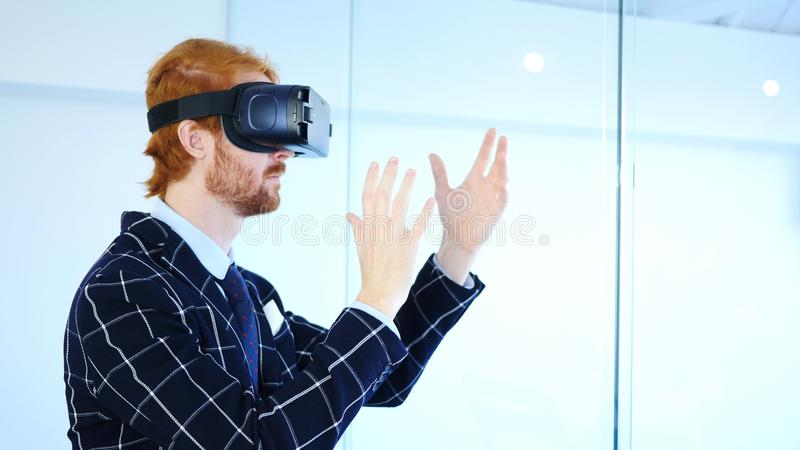 Man wearing virtual reality glasses for Creative Work, VR goggles headset.� stock photo