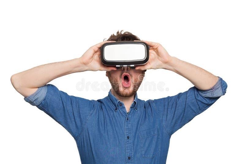 Man wearing virtual reality goggles stock photos