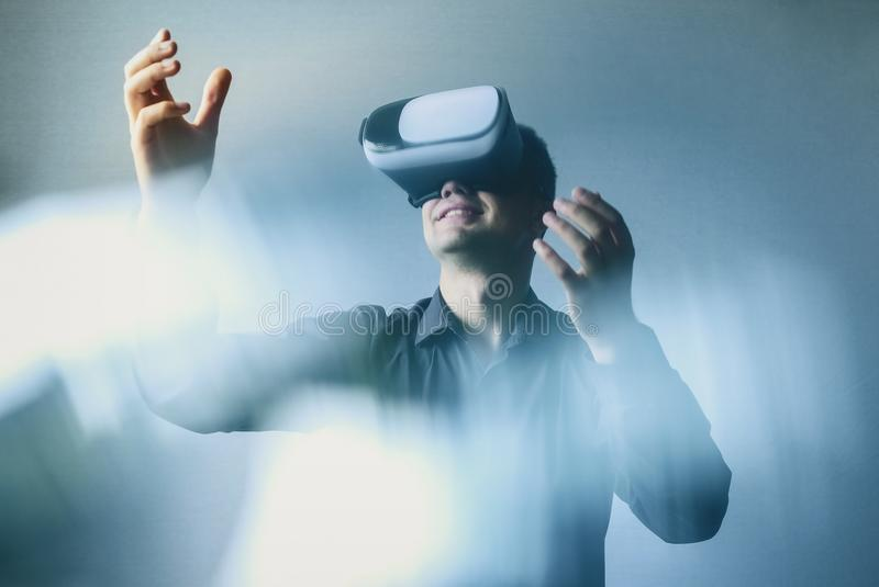 Man wearing virtual reality headset or goggles royalty free stock photography