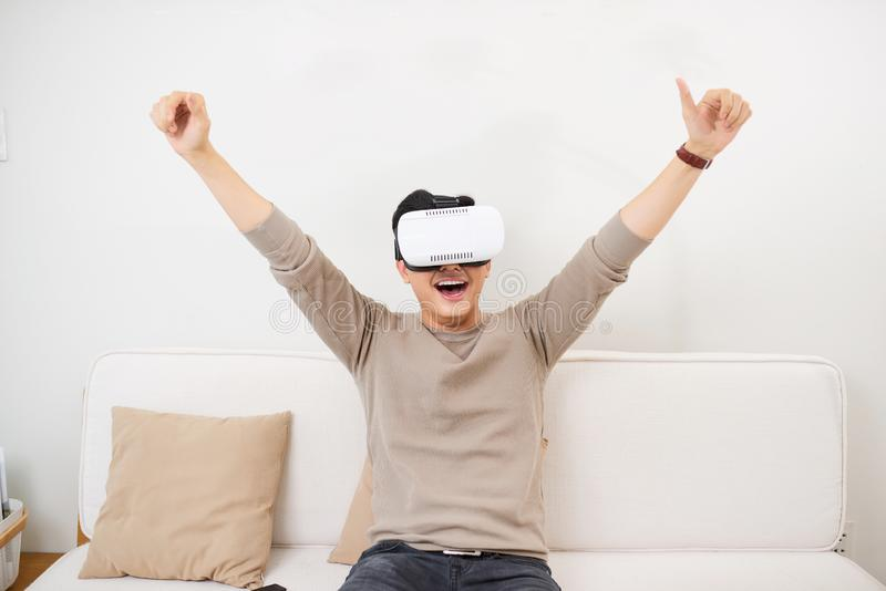 Man wearing virtual reality VR glasses watching soccer football stock images